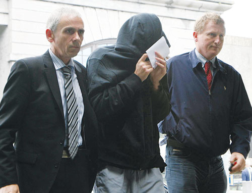 Jakub Fidler (centre)  pictured entering Galway courthouse on Tuesday afternoon. Photo: Mike Shaughnessy