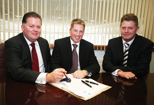 From left to right: David Hogan, chairman Tom Hogan Motors, John Lawlor, BMW network strategy manager and Paul Hogan (FCA), director Tom Hogan Motors, signing the official contract to become the newly appointed BMW & MINI dealer for Galway.