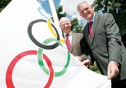 Pictured raising the Olympic flag at their headquarters in Dublin is Olympic Council of Ireland president Pat Hickey (left) with Volkswagen chief executive Bob O'Callaghan.