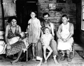 Hard times: Bud Fields and his family, Hale County, Alabama, summer 1936, part of the exhibition of photographs taken by Walker Evens, upstairs at the Aula Maxima, NUI,Galway.