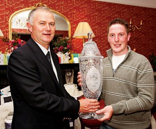 Niall Burke, winner of the Captains Prize at Ballinrobe Golf Club, is presented with his prize by Pat Fahy, Captain Ballinrobe Golf Club. Photo: Michael Donnelly