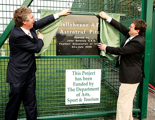 John Delaney, CEO Football Association of Ireland cuts the tape at the official opening of the Ballyheane AFC astroturf pitch assisted by Ballyheane's Walter Tuffy. Photo: Michael Donnelly