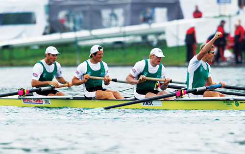 Cormac Folan, second from left, and his teammates celebrate qualifying for the Beijing Olympics.