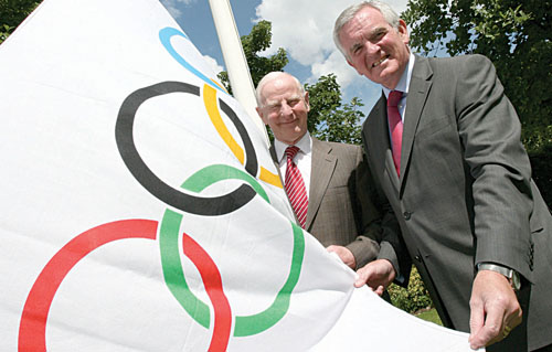 Pictured raising the Olympic flag at their headquarters in Dublin is Olympic Council of Ireland president Pat Hickey (right) with Volkswagen chief executive Bob O'Callaghan.