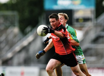 An Cheathru Rua's Edward Ó Sé  and  Claregalway's Ronan O'Flynn in action from the Claregalway Hotel Senior Football Championship game which ended in a draw at Pearse Stadium on Saturday evening. Photo:-Mike Shaughnessy