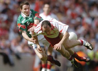Flying into the past: Mayo's Peadar Gardiner tackles Tyrone's Brian Dooher in the All Ireland quarter final in 2004. Photo: Sportsfile