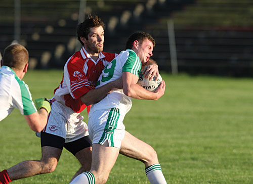 Welcome home: Ballaghaderreen's Pearce Hanley gets a welcoming challenge in last weekend's Mayo Senior Football championship clash agaist Ballintubber. Photo: Michael Donnelly.