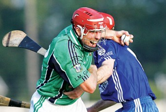 Liam Mellows' Niall McInerney is held by Kiltormer's Brendan Kenny in action from the Safety Direct Senior Club Hurling Championship at Kenny Park, Athenry on Saturday. Photo:-Mike Shaughnessy
