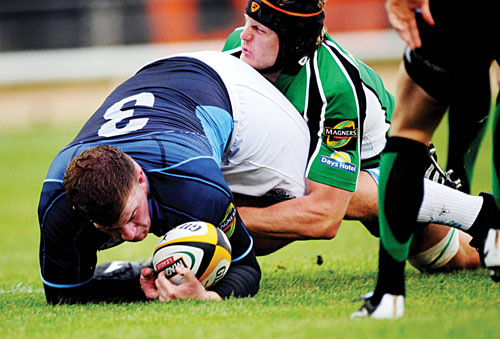 Connacht's Andrew Farley puts in another big hit to stop prop Moray Low in Friday's Magners League clash with Glasgow.