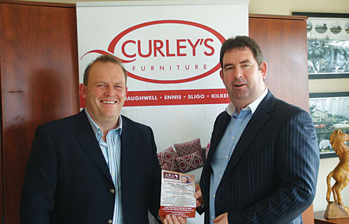 Joe Brady (Monster Organic Ball committee) pictured with John Curley (CEO, Curley's Furniture).