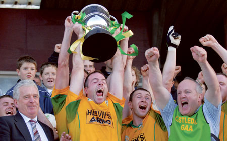 Castledaly Captain, James Galvin lifts the Flanagan Cup.