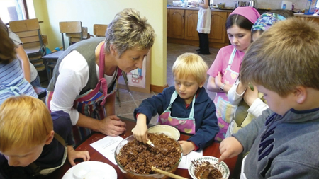 Children enjoy making Rice Krispy buns with Kate Wright at the Clarinbridge Arts Festival.