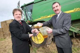 Paddy Murphy, general manager of Continental Tyres Ireland, and Michael Moroney, vice chairman of the Irish Motoring Writers Association, with the raw material and end product of some of Ireland's biofuels.