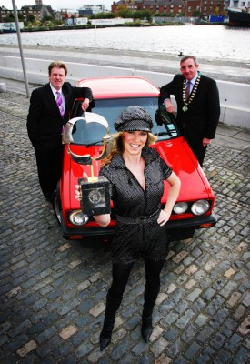 1978-2008 Celebrating thirty years of the Semperit Irish Car of the Year: Paddy Murphy, Semperit Ireland, and Tony Toner, chairman of the Irish Motoring Writers Association, with model Jenny Lee Masterson in 1978-garb at the announcement of the list of runners for the 2009 awards. Also in the picture is a Mk I VW Golf, the car that won the inaugural Irish Car of the Year award in 1978.