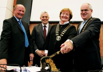 Mayor of County Clare - Madeleine Taylor Quinn and Mayor of County Galway Peter Feeney stamp the contracts at the signing of the N1 Gort to Crusheen Dual Carriageway Design Build Contract watched by Charles Wills of Wills Brothers and John Geoghegan of Siac joint project contractors. Photo:-Mike Shaughnessy