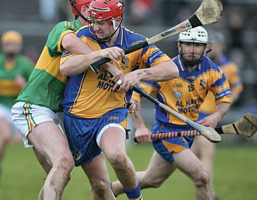 Portumna's Joe Canning is held by Gort's Brian Regan in action from the Safety Direct Senior Hurling Championship decider at Pearse Staium on Sunday. 	Photo:-Mike Shaughnessy