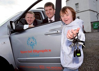 James Brooks, managing director of Kia Motors Ireland, and Matt English, CEO of Special Olympics Ireland, with Special Olympics athlete, Josh Hennessy.