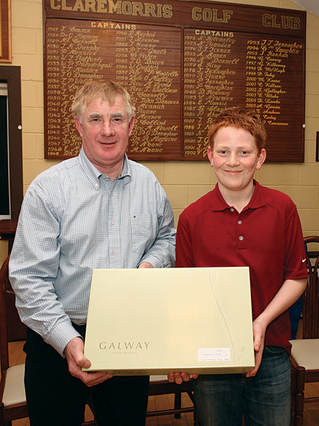 John F Concannon (outgoing captain Claremorris Golf Club) presents first prize in the recent Robert Blacoe Jewellers sponsored competition to Shane McGagh. Photo: © Michael Donnelly.