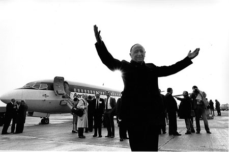 Monsignor James Horan on the October 25 1985 before boarding the first commercial flight from Ireland West Airport Knock. The Aer Lingus Boeing jet aircraft (737s and a 707) was bound for Rome. The first airline ticket produced at the Airport was an Aer Lingus ticket for passenger Monsignor James Horan.