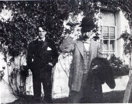 A young WB Yeates and George Moore outside Coole, Co Galway, 16 April, 1915.
