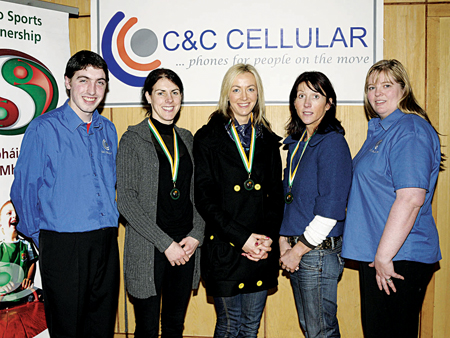 Pictured in Westport Leisure Centre, Mayo AC bronze medal winners in the Dublin City Marathon, l-r: Shane Mortimer, manager, C&C Cellular Westport; Mary Gleeson; Catherine Conway; Cathy Connolly; and Jacqueline McCormack, area manager, C&C Cellular. Photo: Studio 094.