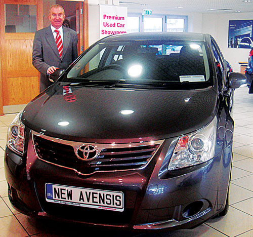Tony Burke, dealer principal at Tom Hogan Motors, Ballybrit, with the new Toyota Avensis. Both the new iQ minicar and new Avensis are now showing in the showrooms at Ballybrit.