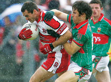 Billy Joe Padden gets to grips with Derry's Sean Marty Lockhart in a past encounter between Derry and Mayo. Photo: Sportsfile.