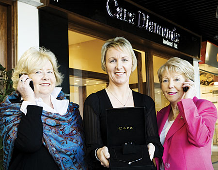 Adding some sparkle to this year's Valentine's Ball in aid of NBCRI is Aine Burke of Cara Diamonds, Briarhill Shopping Centre, who donated a stunning diamond pendant and matching earrings valued at €3,500 which, all attending the event have the chance to win during the 'Dial-A-Diamond' section of the evening. Also in the photo are Patricia Caffrey (chairperson NBCRI Finance & Planning Committee) and Anna O'Connie, (chairperson, The National Breast Cancer Research Institute).