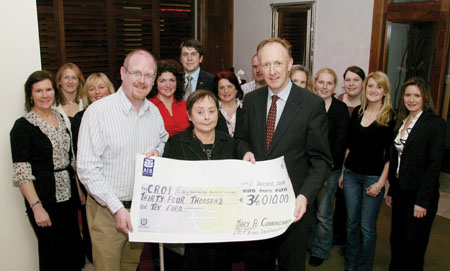 Mary Cunningham and Mark Keane, present a cheque to Neil Johnson, CEO, Croí for €34,010 which is the proceeds from the annual Gala Christmas Cabaret, held in aid of Croí at the Radisson SAS Hotel. Also in photo are committee members from left: Colette Keaveney, Edel Lambe, Croí, Patty Wheelar, Rita Tansey, James Dilleen, Radisson SAS Hotel, Marian Beatty, Martin McDonnell, Catherine McCurry, Marie Hennelly, Eilish Deffew, Sonia Carey, and Bernice Devery.