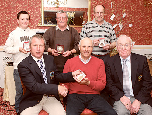 Pictured at the presentation of the Monthly Medal Competition at Ballinrobe Golf Club, front from left: Paul Hynes, captain Ballinrobe Golf Club, presents the gold medal to Charlie O'Sullivan. On right is club president Pat Holian. At back from left: Aaron Darcy (67 nett) with silver medal; Peter Flaherty, 80 gross; and Jim Sheridan, 69 nett bronze. Photo: © Michael Donnelly.