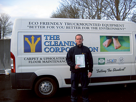 Ben Quigley of the Cleaning Corporation celebrates passing the IICRC examinations.
