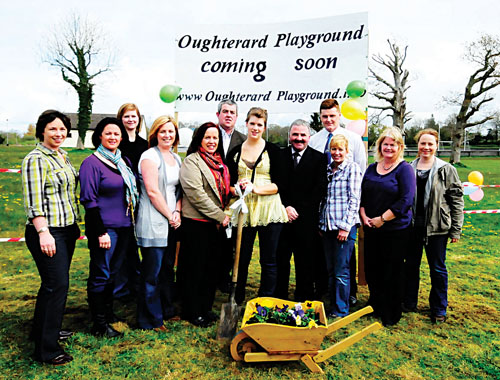Vanessa Butler ( Maid of the Parade, Oughterard 2009 ), and members of the committee at the sod-turning ceremony for the long-awaited playground in Oughterard.			Photo: Tom Broderick
