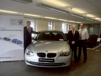 From L to R: Welcoming the Sterling Collection are: Alex Dalgarno, BMW sales executive; Tom Moore, BMW dealer principal; and Ray Kenny, BMW sales manager at Tom Hogan Motors.