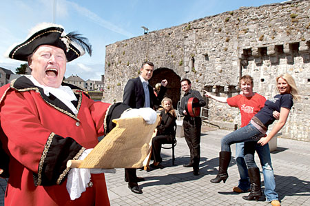 Town Crier Liam Silke officially launches Galways newest area, ' The Latin Quarter' on the Spanish Arch on Monday morning. Pictured joining in the fun are, Ronnie Greaney, chairman of the committee, Lindsay Moynagh and Diarmuid Hurley from Music at the Crossroads, the inimitable Hector O'hEochagain and Hannah Healy Photo: Reg Gordon.