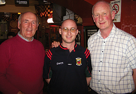 Playwright Benny McDonnell flanked by former Kilkenny hurler Eddie Keher (left) and Kilkenny manager Brian Cody (right).