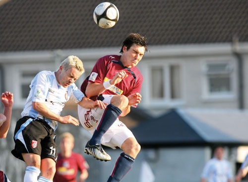 Paul Cooke of Galway United and Liam Kearney of Derry City clash at Terryland Park. Photo:- Mike Shaughnessy