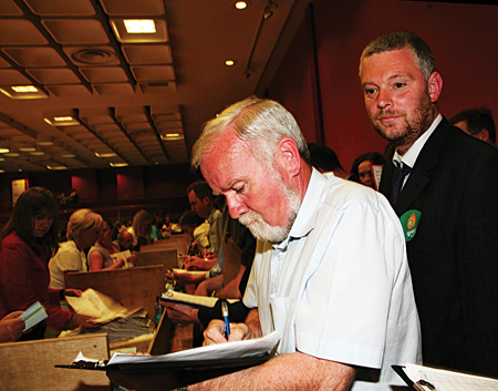 Varying fortunes — Cllr Donal Lyons tots up the figures to his impressive total which in the background, Niall O Brolchain realises that for the second time in two years, he has been rejected by the electorate. Photo: Mike Shaughnessy