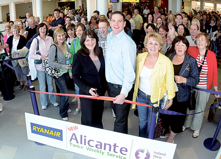 Cutting the ribbon at the launch of the new twice weekly scheduled service to Alicante International Airport from Ireland West Airport Knock with Ryanair are Lesley Kane (head of sales and marketing, Ryanair) and John McCarthy (operations and commercial manager, IWAK).
