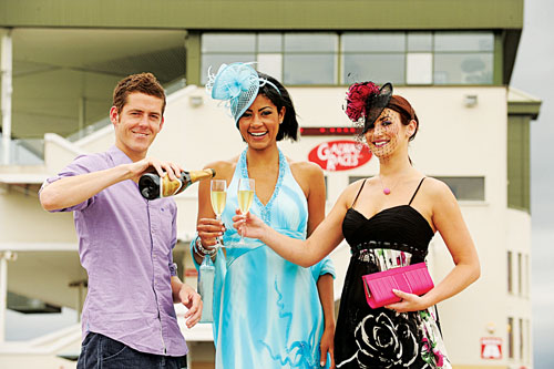 Jockey Andrew McNamara pictured with busy models Layla and Lynda who skipped from the launch of the races in the g hotel to the racecourse for this shot.