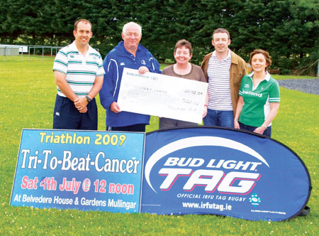 David Farrelly handing over a cheque for €500 for a  fancy dress night hosted by Mullingar tag rugby to Anne Coleman from Tri To Beat Cancer. Also pictured are Ollie Hodges, IRFU, John O'Reilly, and Olive Robinson