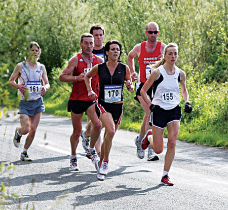 Claremorris women's race winner Catherine Conway (Mayo AC, No 155) and second placed Mary Gleeson (Mayo AC, No 170) lead a group after two miles,