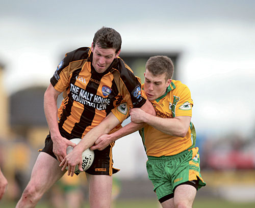 Colm Colleran of Mountbellew/Moylough and Cathal Silke of Corofin.  Photo:- Mike Shaughnessy