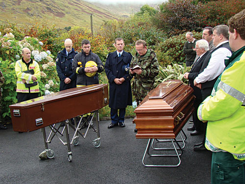 Fr. Tom Brady, Chaplain, 1st Infantry Battalion, Renmore Army Barracks, Galway, blessing the remains of the two Air Corps pilots who died in the plane accident near Cornamona.