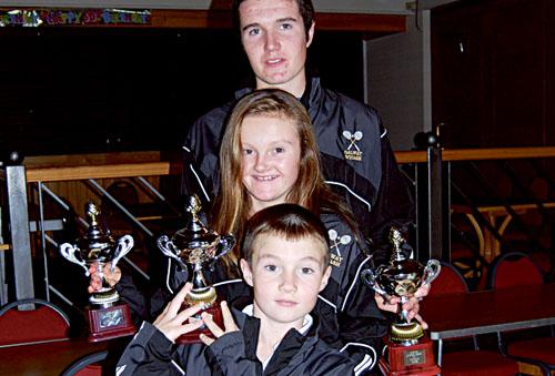 Donal, Roisin, and Conor O'Shea with their trophies after victory in the Ulster Junior Squash Open.