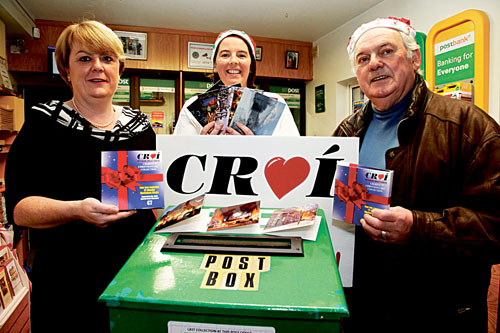 Pictured at the launch of this year's Croí Christmas card pack campaign 'Posting a positive thought this Christmas', are L-R Esther Daly, Salthill postmistress, Seona Joyce, Croi and local heart patient Tony O'Connor.