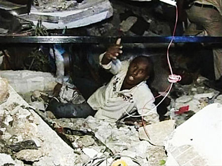 A man calls for help while being trapped at the Port-au-Prince University, after a major earthquake struck, in Port-au-Prince.