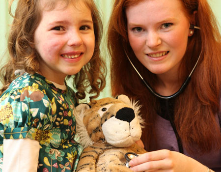 Four-year-old Hannah Baumann was at NUI Galway as details of the fifth annual Teddy Bear Hospital were announced this week. The event is to take place at NUI Galway from 28-29 January, when some 1,000 sick teddy bears will be admitted to the hospital, accompanied by their owners, 1,000 primary school children between the ages of three and eight. Hannah is pictured here with NUI Galway medical student Sharon Cowley from Rathlee, Co Sligo. Photograph by Aengus McMahon