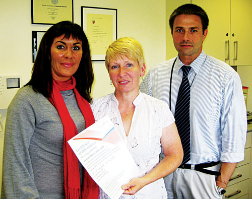 Jeanette Haynes BNSc RGN (left) of Body Benefits medical laser and skincare clinic Galway, receiving her BTEC professional certificate in medical laser, light therapies, and non surgical procedures from course directors Dr Elizabeth Raymond Browne and Dr Phillip Dobson of LCS Laser Academy UK.