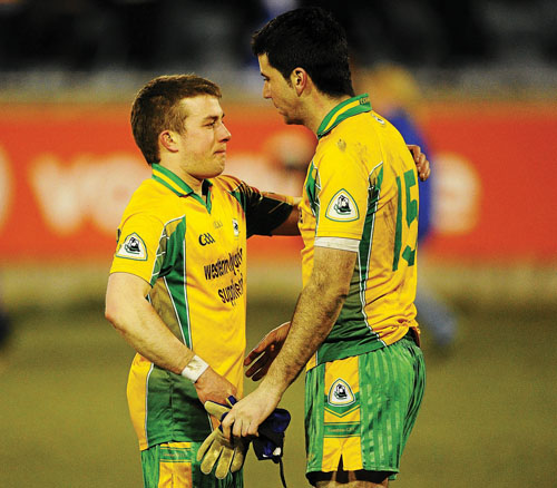Corofin captain Kieran Cooper, right, is comforted by his teammate Joe Canny after Corofin lost the AIB GAA Football All-Ireland Senior Club Championship semi-final refixture to St Gall's, at Parnell Park, Dublin.
