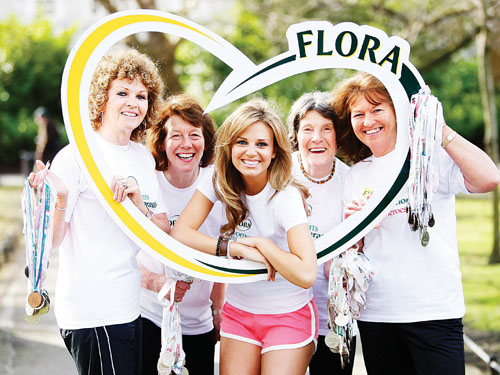 Ruth O'Neill (centre) is pictured learning the ropes from Flora Women's Mini Marathon veterans Trish Horgan, Margaret Goodwin, Betty Hand, and Ria Stewart, who have participated in all 27 events!